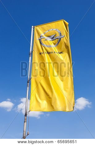 Samara, Russia - May 25, 2014: The Flag Of Opel Over Blue Sky. Opel Is A German Automobile Manufactu