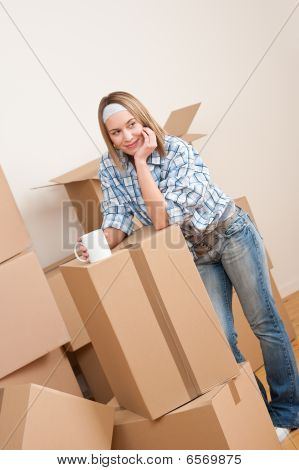 Moving House: Woman With Box In New Home
