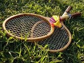 stock photo of shuttlecock  - badminton rackets and shuttlecock in the grass - JPG