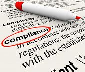 stock photo of glossary  - Compliance word circled dictionary definition meaning rules regulations laws - JPG