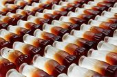 foto of coca-cola  - Cola bottle background concept great for manufacturing or factories - JPG