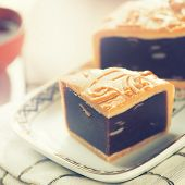 image of mid autumn  - Traditional red beans paste mooncakes on white plate with teacup - JPG