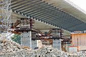 image of scaffold  - steel bridge construction with scaffolding and welding - JPG