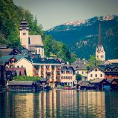 Vintage retro effect filtered hipster style travel image of Austrian tourist destination Hallstatt village on  Hallst????????????�tter See in Austrian alps. Salzkammergut region, Austria poster