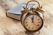 stock photo of clocks  - Clock and Bible on wood - JPG