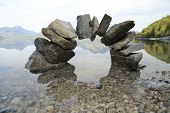 stock photo of calming  - a bridge with stones and lake background - JPG