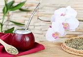 image of calabash  - Tea mate in the calabash and orchid on stone wall background - JPG