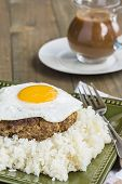 picture of loco  - Loco Moco a traditional Hawaiian dish of teriyaka flavored ground beef patty and a fried egg on a bed of rice smothered in gravy - JPG