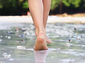 picture of footprints sand  - Girl walking on sand beach leaving footprints - JPG