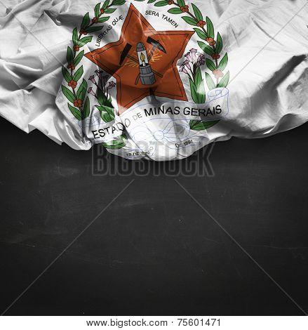 Minas Gerais Coat of Arms waving flag on blackboard