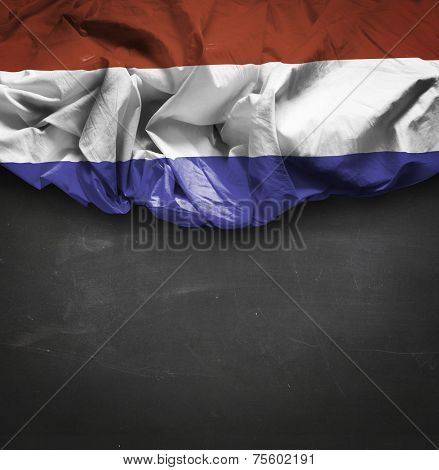 Netherlands waving flag on blackboard