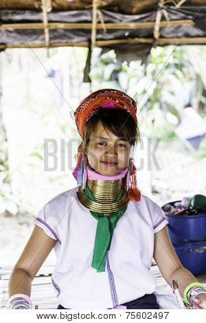 CHIANG MAI, THAILAND - CIRCA MAY 2014: Long Neck woman posing for a portrait at Karen Long Neck hill tribe village in Chiang Mai, Thailand.