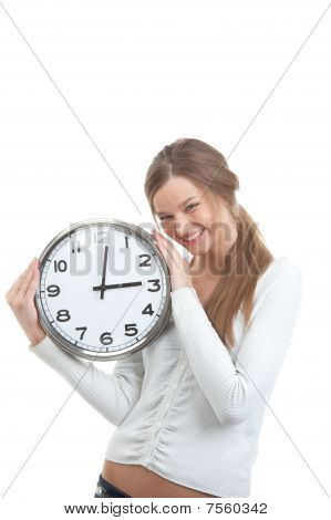 Portrait Of A Smiling Girl Holding Clock
