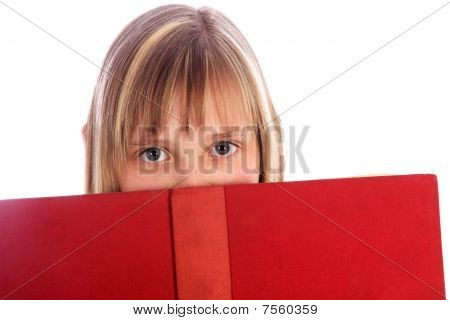 Young Girl Looks Out On A Red Book
