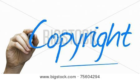 Copyright hand writing with a blue mark on a transparent board