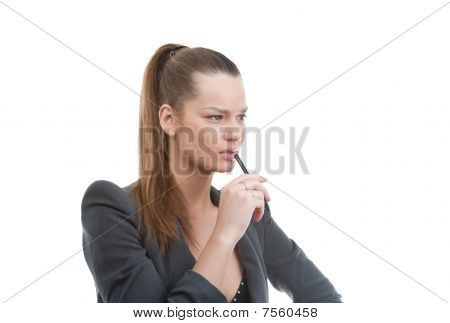 Portrait Of Young Business Woman Holding Pen In Her Hand