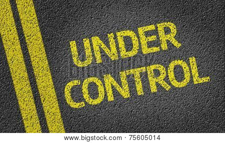Under Control written on the road