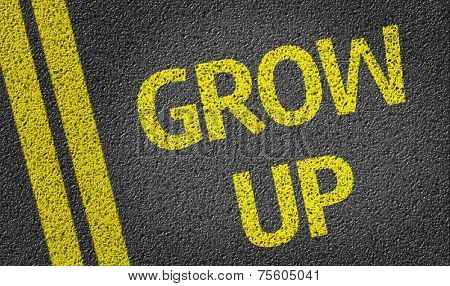 Grow Up written on the road