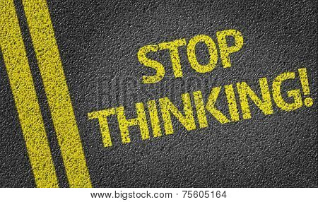 Stop Thinking! written on the road
