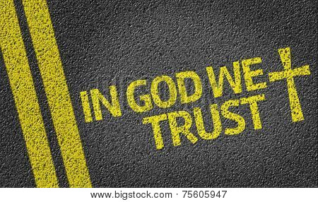 In God We Trust written on the road