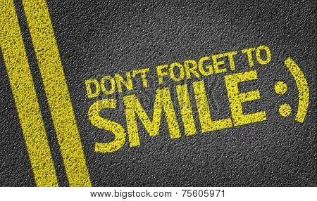 Don't Forget to Smile written on the road