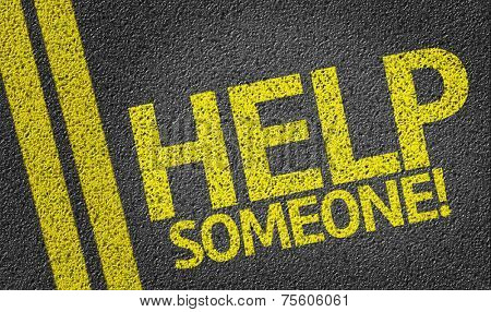 Help Someone written on the road