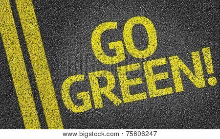 Go Green! written on the road
