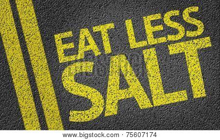 Eat Less Salt written on the road
