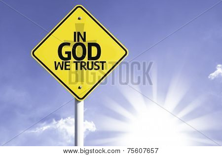 In God We Trust road sign with sun background