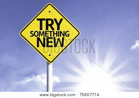 Try Something New road sign with sun background