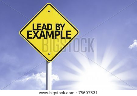 Lead by Example road sign with sun background