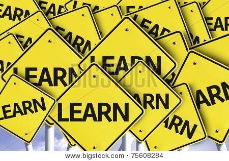 Learn written on multiple road sign