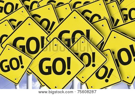 Go! written on multiple road sign