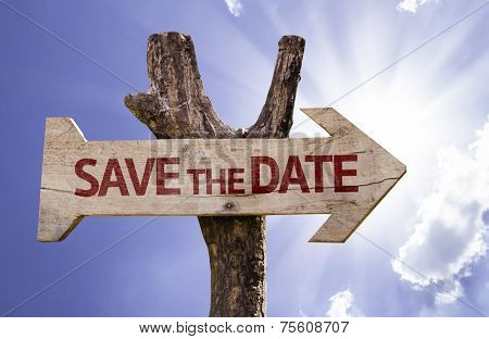 Save the Date wooden sign on a beautiful day