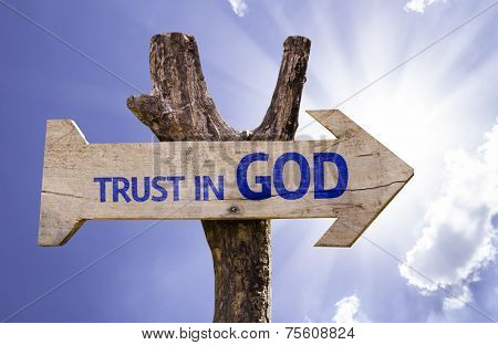 Trust in God wooden sign on a beautiful day