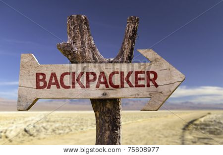Backpacker wooden sign isolated on desert background