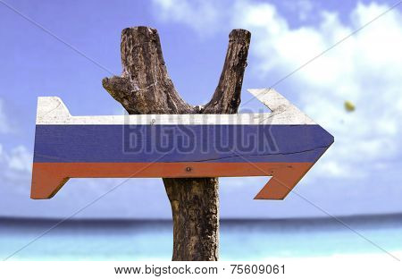 Russia wooden sign with a beach on background