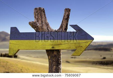 Ukraine wooden sign isolated on desert background