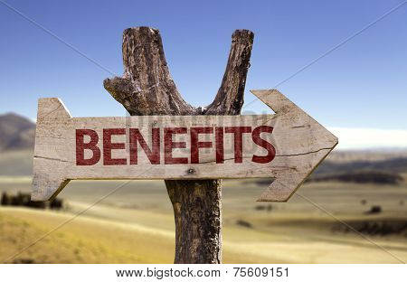 Benefits wooden sign on desert background