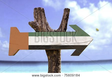 United Arab Emirates wooden sign with a river on background