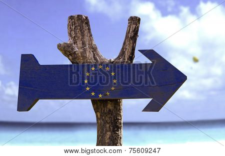 European Union wooden sign with a beach on background