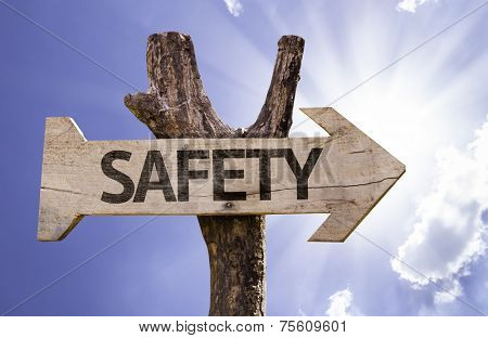 Safety wooden sign on a beautiful day