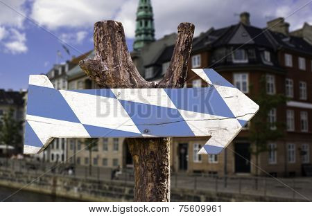 Bavaria wooden sign with a city on background
