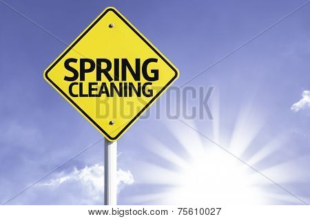 Spring Cleaning road sign with sun background