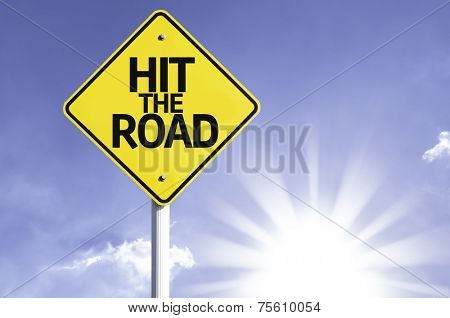 Hit The Road road sign with sun background
