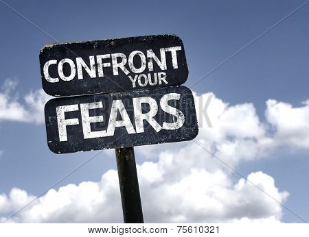 Confront Your Fears sign with clouds and sky background