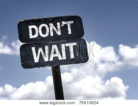 Don't Wait sign with clouds and sky background