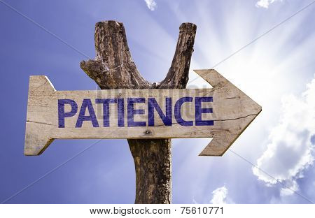 Patience wooden sign with a sky background