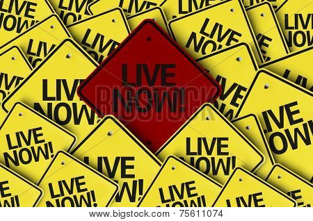 Live Now! written on multiple road sign