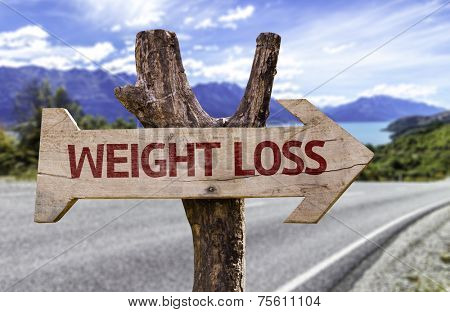 Weight Loss wooden sign with a street background